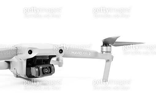 Rostov, Russia - July 22, 2020: Quadcopter DJI Mavic Air 2 with camera and straightened blades on white background, copy space