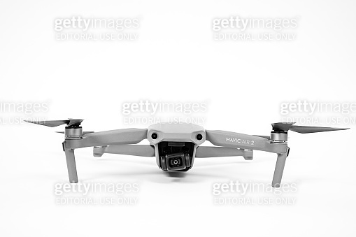 Rostov, Russia - July 22, 2020: Quadcopter DJI Mavic Air 2 with camera and straightened blades on white background, copy space.