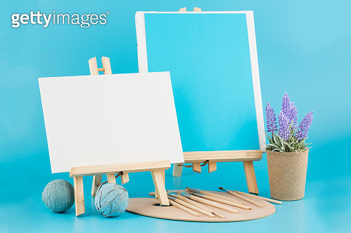 Two wooden easels