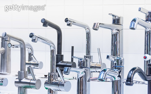 Various water faucets for kitchen and bathroom.