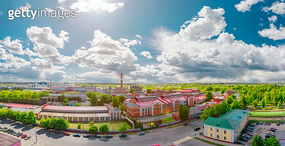 Landscape. Paper mill in the city. Old architecture of the 19th century on a bright summer day with clouds on a blue sky. Aerial view