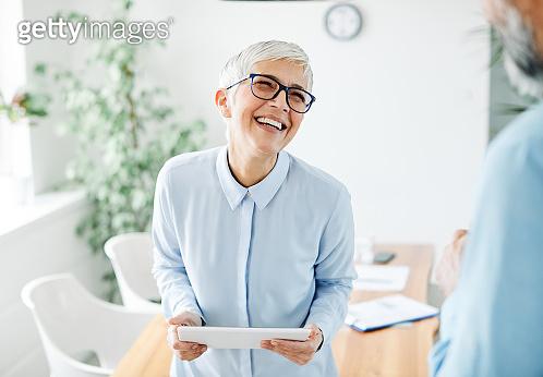 senior business woman gray hair tablet office happy portrait mature