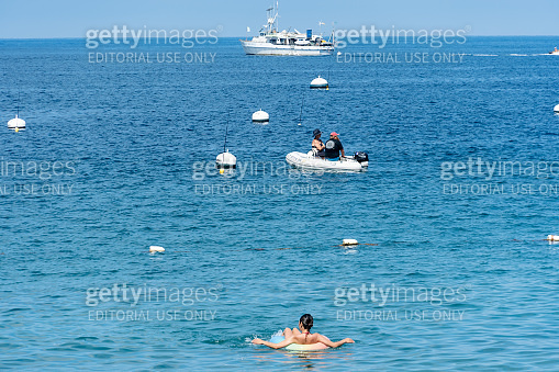 Woman relaxing and floating in the ocean on a inflatable floatie