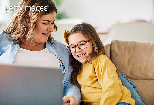 laptop computer education mother children daughter girl familiy childhood home child parent