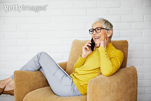 beautiful senior mature woman portrait gray hair mobile phone cell technology smartphone