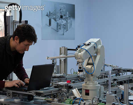 Engineer is working on a smart factory prototype.