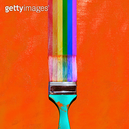 Brush and LGBT symbol on orange background. LGBT pride month in June.