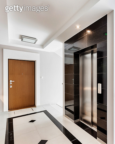 Interior of an apartment building with a corridor and a blank wall