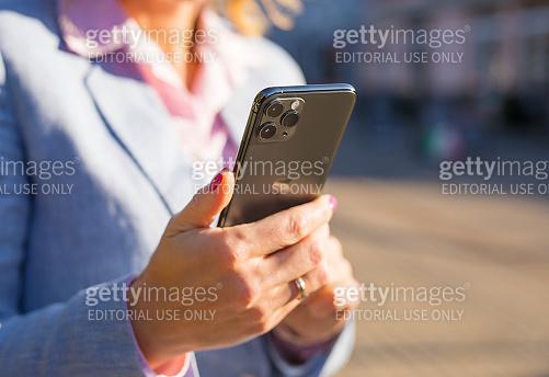 Woman using Apple iPhone 11 Pro