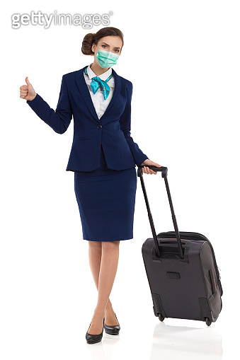 Stewardess With Trolley Bag And Is Showing Thumb Up