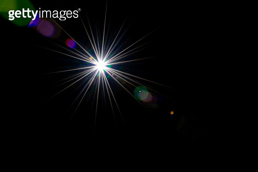 Flare background. Sunlight ray flash effect on black. Star spot or sun shine glow light on lens. Gleams rounded and hexagonal shapes, rainbow halo