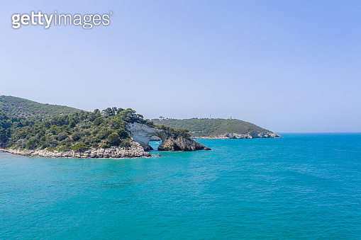 Adriatic Sea and natural arch on shore, Gargano National Park, Puglia, Italy