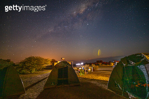 People camping at night in desert, Namibia, Africa