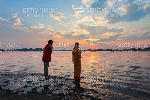 Unidentified pilgrims praying in India