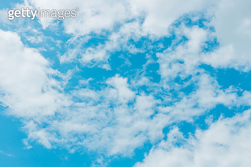 Blue sky with white gray clouds.