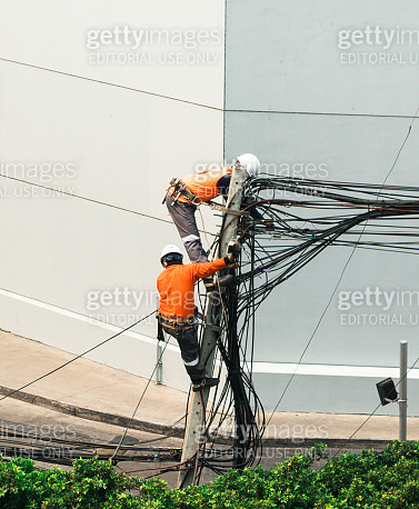 Electricians are climbing on electric poles