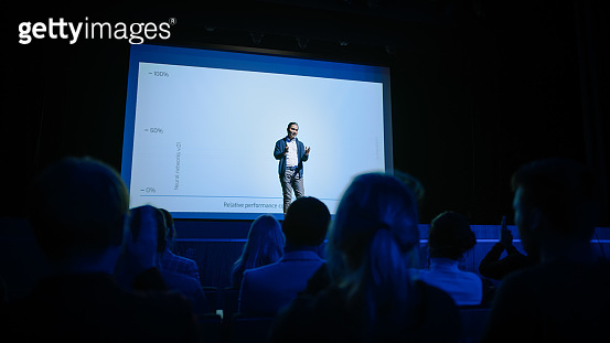 Conference Stage: Speaker Presents New Product, Talks about Performance, Neural Networks, Artificial Intelligence, Big Data and Machine Learning. Live Business Event with Large Audience