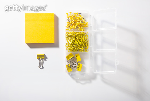 Yellow paper clips on white background