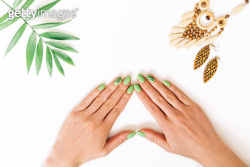 Female hands with beautiful stylish green manicure.