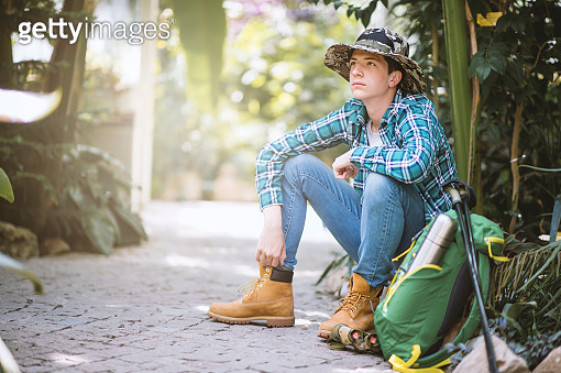Teenager boy resting in public garden