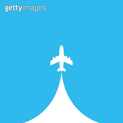Airplane in the sky. White airplane on blue background. Jet plane with inversion trail .