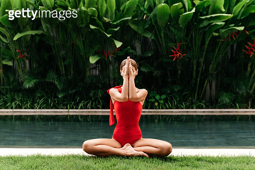 Young woman practicing yoga outdoors.