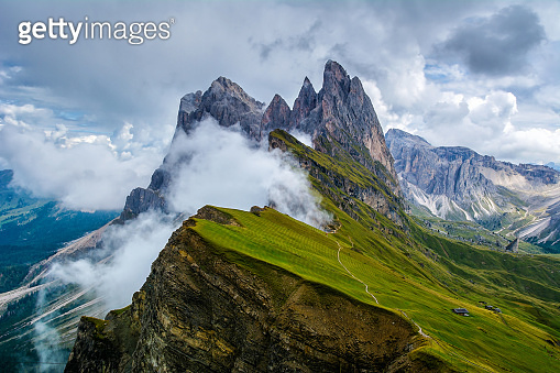 Wonderful landscape of  the Dolomites Alps. Odle mountain range, Seceda peak in Dolomites, Italy. Artistic picture. Beauty world.