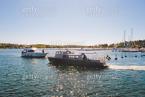 The city of nynashamn in Sweden. The embankment of the Baltic Sea. Berth, parking and boats, ships