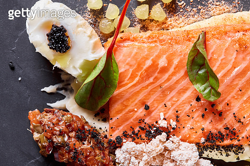 Closeup Salmon steak fillet with eggs and vegetables. Restaurant menu, a series of photos of different dishes