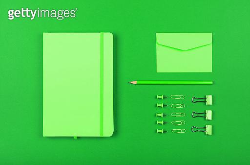 Neatly organized stationery flat lay of green