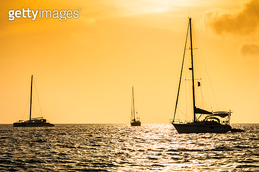 Sailboats at sunset in a tropical island