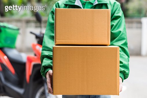 Deliveryman give shopping parcel boxes