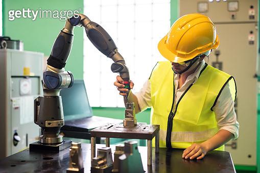 Factory inspector check lathe robot arm