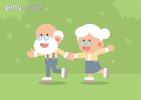 Elderly couple skating on rollerblades