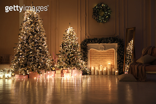 Festive room interior with Christmas trees