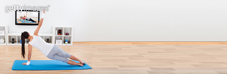Woman practising yoga at home