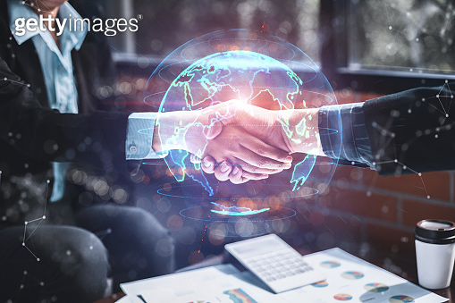 Success business and partnership business concept, Business people shake hands to agree to join business and digital Infographic global. Success technology and business partnership