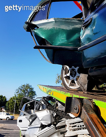 Accident-damaged cars stacked on vehicle transporter
