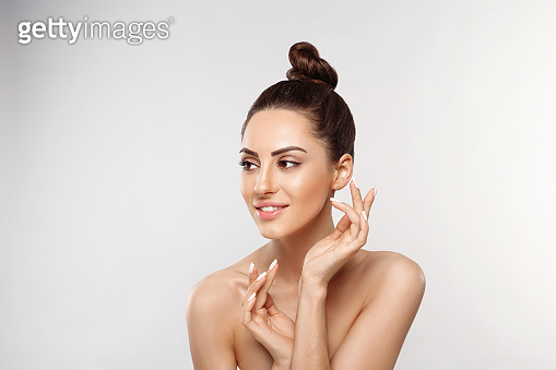 Beautiful woman portrait, skin care concept, beautiful skin. Portrait of female hands with manicure nails touching her face. Spa. Girls cosmetics. Facial treatment.