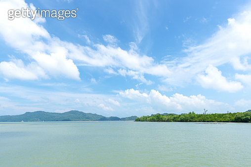 Tropical sea and island with blue sky background