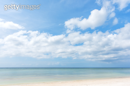 Tropical sea and beach with blue sky blurred abstract background