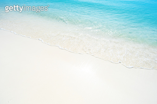 Soft wave of turquoise sea on sandy beach
