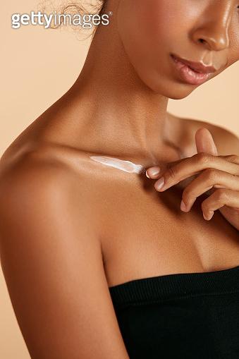 Skin care. Closeup woman's body with cosmetic cream on skin