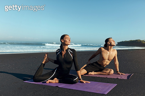 Beach. Woman And Man Workout In Morning. Sport Couple In Fashion Sportswear Doing Stretching Exercise For Flexibility On Yoga Mat. Training On Summer Vacation As Part Of Active Lifestyle.