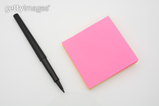 Black pen or pencil to write on paper.