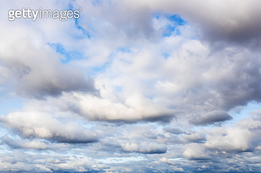 many cumulus clouds in blue sky in September