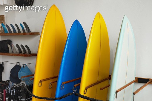 Surf Shop. Set Of Surfboards Standing In Stack At Rental Place On Beach. Water Sport Equipment, Active Lifestyle At Tropical Ocean.