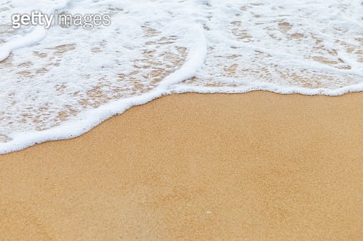 White wave on brown sand beach, nature and environmental concept background