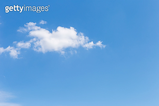 White cloud over clear blue sky