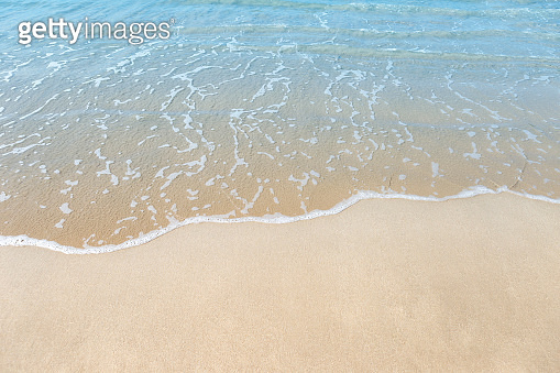Beach background, empty fine sand beach and blue sea water